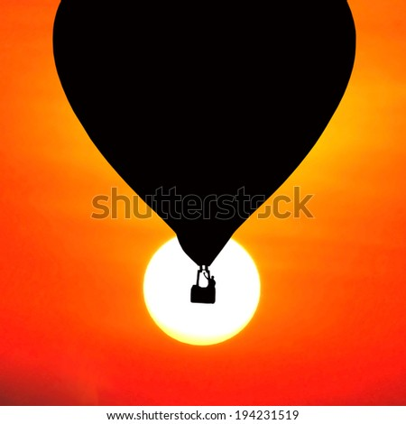 balloons silhouette on sunset background. - stock photo