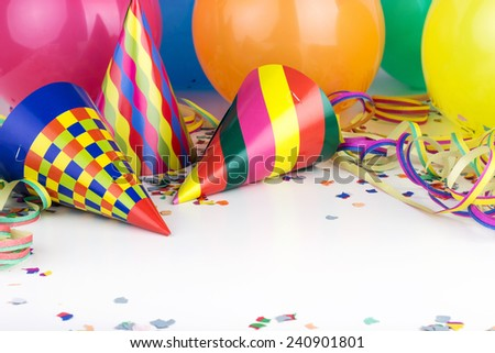 Balloons, streamers, confetti and party hats/party/carnival - stock photo
