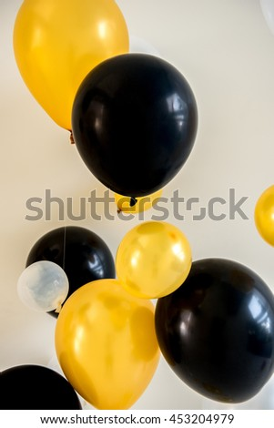 balloons yellow and black color on backdrop, Design for party background. Party balloons celebration background golden texture - stock photo
