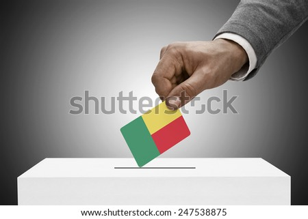 Ballot box painted into national flag colors - Benin - stock photo