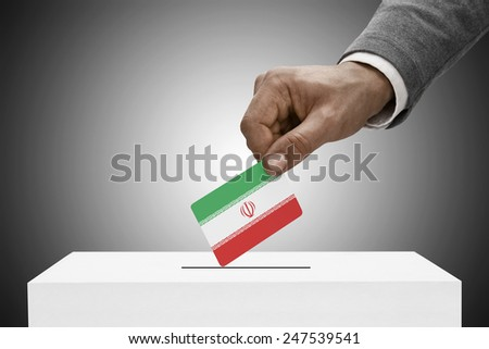 Ballot box painted into national flag colors - Iran - stock photo