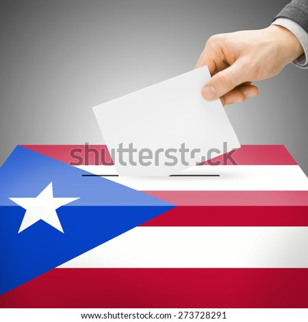 Ballot box painted into national flag colors - Puerto Rico