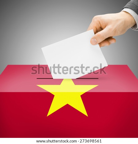 Ballot box painted into national flag colors - Vietnam - stock photo