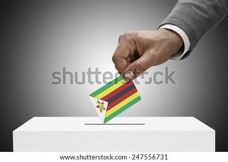 Ballot box painted into national flag colors - Zimbabwe - stock photo