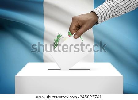 Ballot box with national flag on background - Guatemala - stock photo
