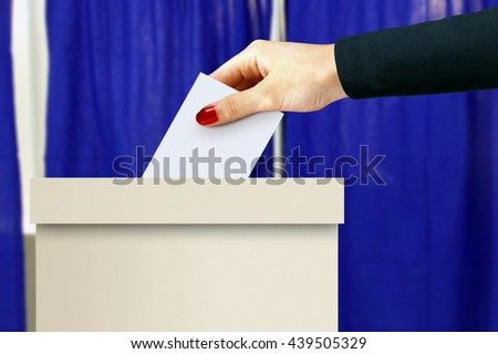 Ballot box with women hand casting a vote - stock photo