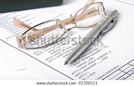 Ballpoint pen,glasses and  report