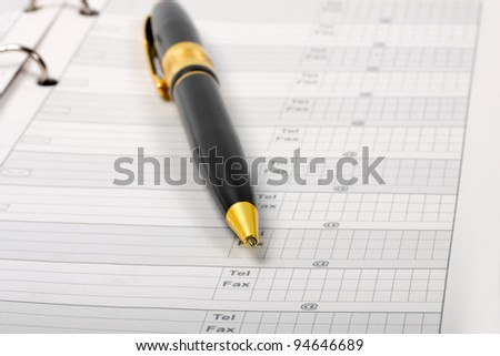 Ballpoint Pen in Phone Book business - stock photo