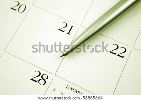 Ballpoint pen on calendar page - stock photo