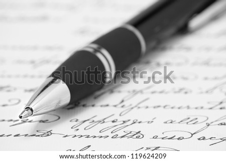 Ballpoint pen on hand-write paper in black and white - stock photo