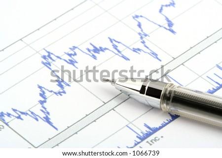 ballpoint pen on stock chart - stock photo