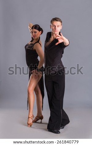 Ballroom dancing. Man and woman posing in dance pose on white. Man and woman dancing ballroom dances. Beautiful man and woman doing the dance steps. Dance poses. - stock photo