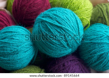 Balls of colored yarn. Multi-colored wool yarn in balls