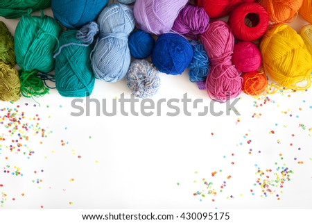 Balls of colored yarn. View from above. All the colors of the rainbow. Sample knit. Crochet. - stock photo