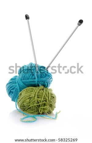 Balls of green and blue  knitting wool or yarn, with silver knitting needles. - stock photo