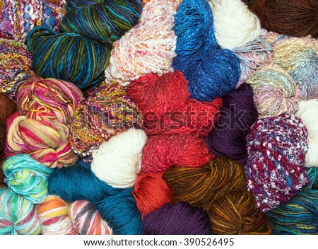 Balls of muted retro natural wool balls - stock photo