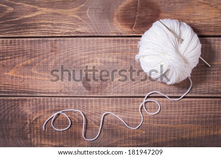 Balls of yarn for knitting on wooden boards - stock photo