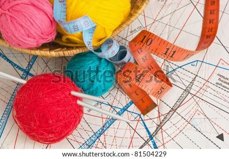 balls of yarn on a background pattern - stock photo