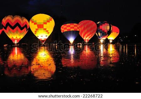 Balluminaria 2008, The world's largest hot air balloon glow reflected in the frozen water of Mirror Lake in Eden Park Cincinnati Ohio USA - stock photo