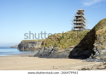 ballybunion castle on the cliffs surrounded by scaffolding while under repair - stock photo