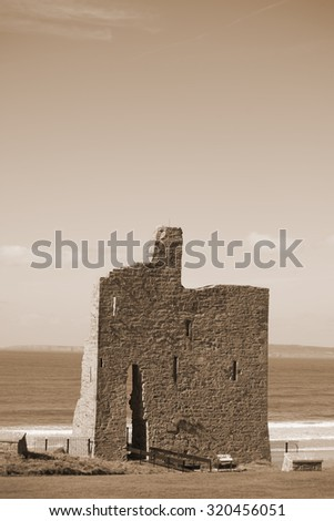 ballybunion castle ruins on the wild atlantic way in county kerry ireland as seen from the land - stock photo