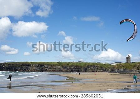 Ballybunion, Ireland - July 5, 2014: lone kite surfer getting ready at ballybunion beach on the wild atlantic way in county Kerry, Ireland - stock photo