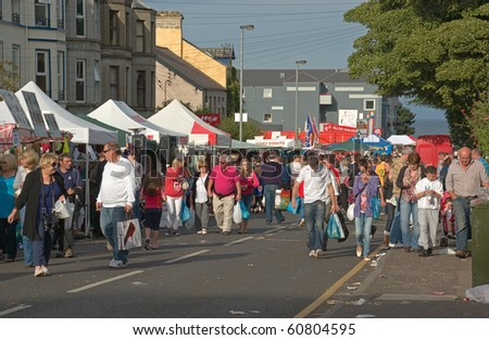 BALLYCASTLE, N. IRELAND - AUGUST 31: People browse among the crowded traditional market stalls at the famous annual Ould Lammas Fair on August 31, 2010 in Ballycastle, N. Ireland.