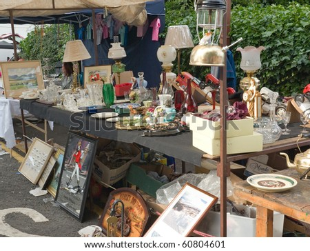 BALLYCASTLE, N. IRELAND - AUGUST 31:Unidentified woman sells antiques at the Ould Lammas Fair on August 31, 2010 in Ballycastle, N. Ireland. This annual market is now over three centuries old. - stock photo