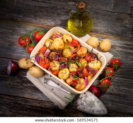 Balsamic Roasted Potatoes & Tomatoes   - stock photo