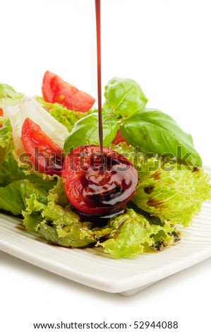 balsamic vinegar falling down over salad - stock photo
