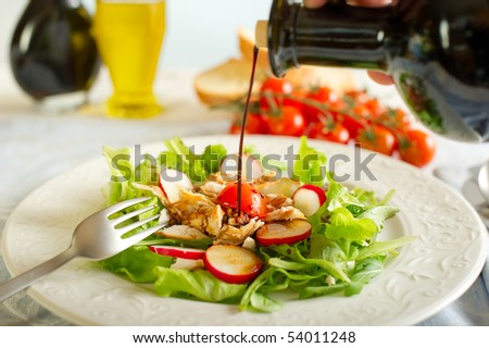 balsamic vinegar over chicken salad - stock photo