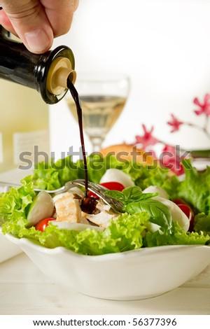 balsamic vinegar over chicken salad - stock photo