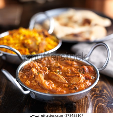 balti dish with butter chicken indian curry shot with selective focus - stock photo