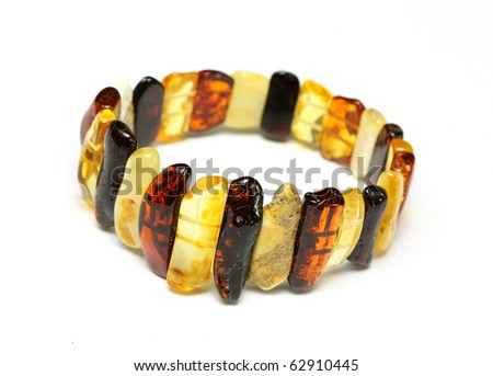 Baltic amber bracelet isolated on white - stock photo