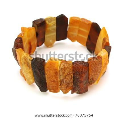 Baltic amber bracelet isolated on white - stock photo