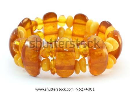 Baltic amber bracelet on white background - stock photo