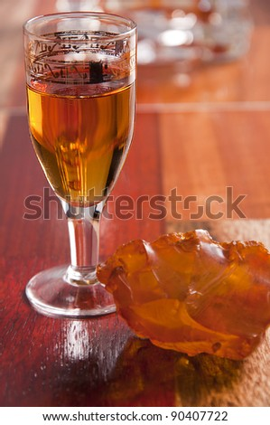 Baltic amber liqueur for high blood-pressure and rheumatism - stock photo