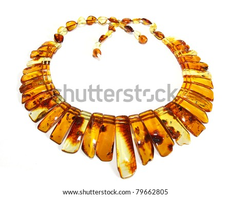Baltic amber necklace isolated on white