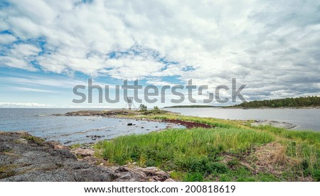 Baltic coastline with sea grass and a nautical sign, Sweden - stock photo