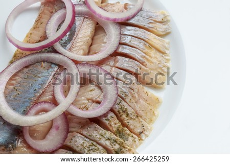 Baltic oiled herring with purple onion - stock photo