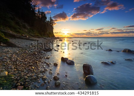 Baltic sea and Cliff of Orlowo at sunrise, Poland - stock photo
