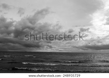 Baltic Sea at cloudy day. Black and white.