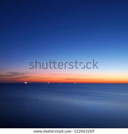 baltic sea bay with ship at the horizon - stock photo