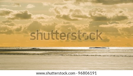 Baltic Sea in March, ice, snow and open water on the horizon. - stock photo