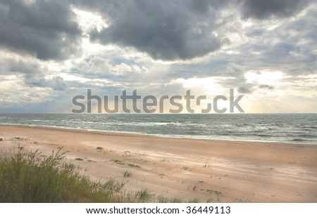 Baltic sea shore at sunset in summer - stock photo