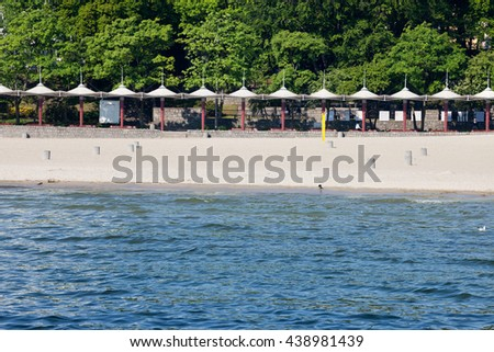 Baltic Sea urban beach in city of Gdynia, Poland - stock photo