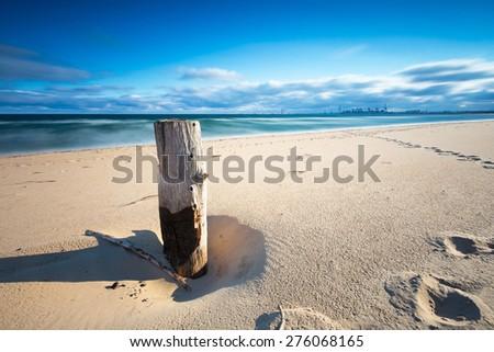 Baltic shore. Beautiful dramatic weather seascape of polish shore of Baltic sea. - stock photo