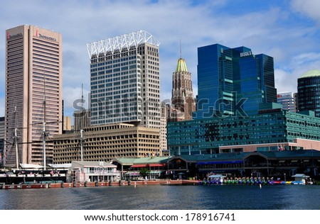 Baltimore, Maryland - July 23, 2013:  View of modern office towers on Pratt Street with U. S. S. Constellation and Inner Harbour Pavilions - stock photo