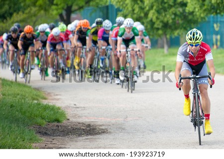 BALTIMORE, MARYLAND - MAY 18: A cyclist pulls ahead in the elite men's competition at BikeJam on May 18, 2014 in Baltimore, Maryland - stock photo