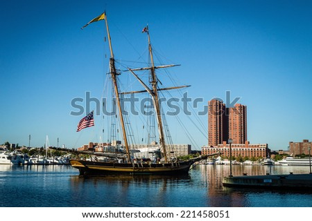 BALTIMORE, MARYLAND-SEPTEMBER 27-A historic tall ship sailing the Inner Harbor on September 27 2014 in Baltimore Maryland. The Inner Harbor is a popular tourist destination. - stock photo